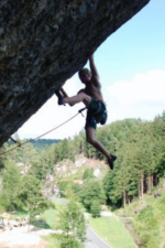 Adam Leading Climbing on an Overhanging Rock