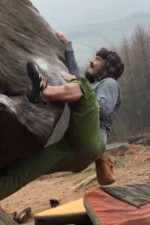Ben crushing a hard bouldering problem