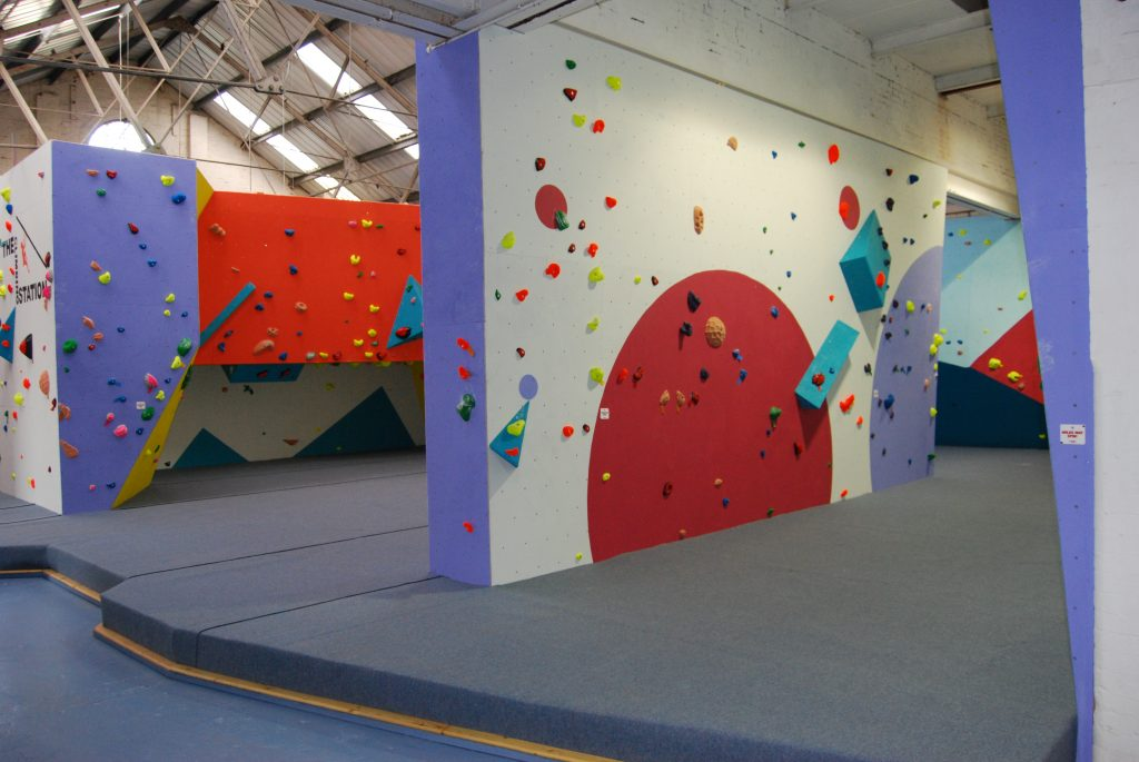 Vertical and roof sections of climbing wall