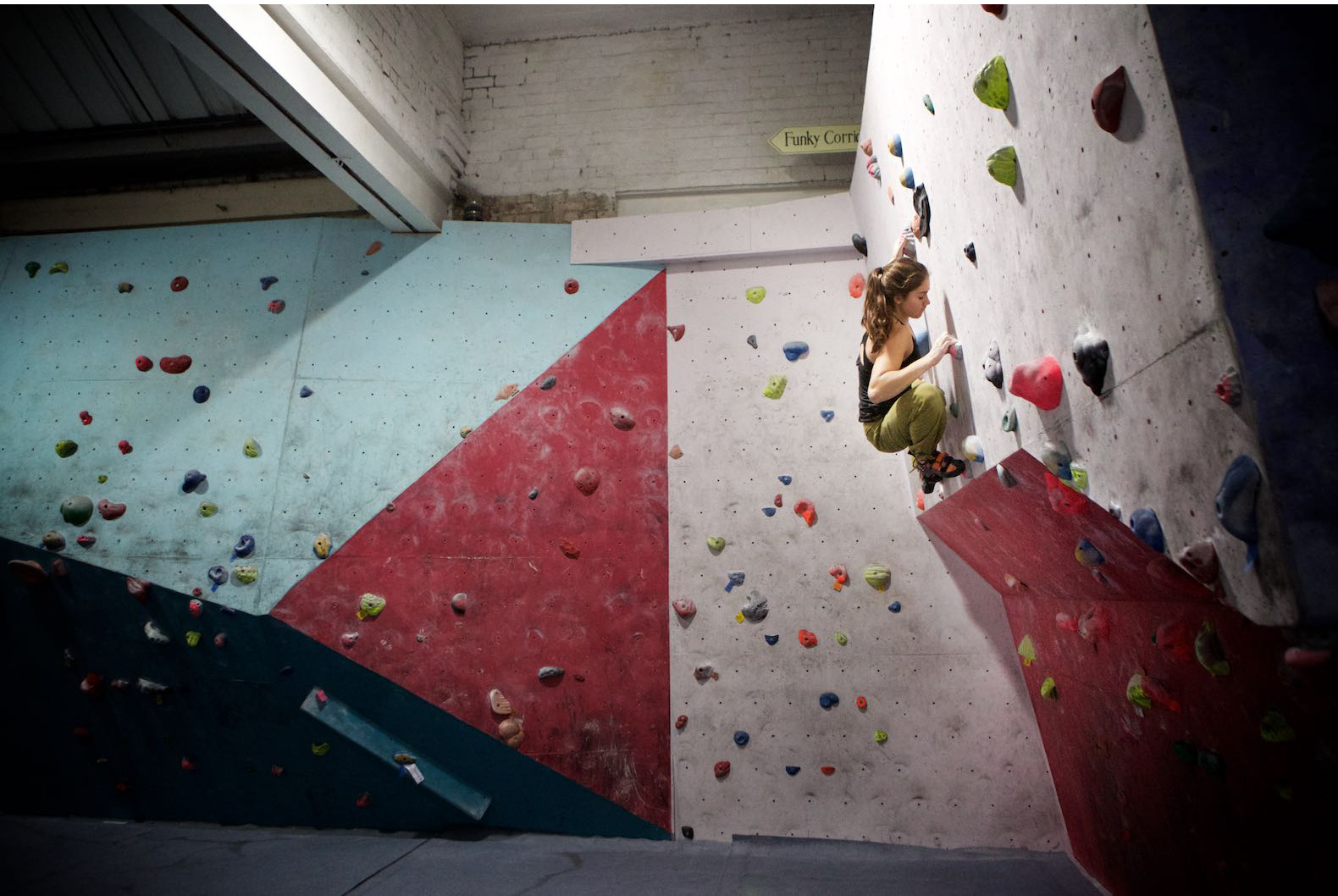 Teen climber above stepped wall