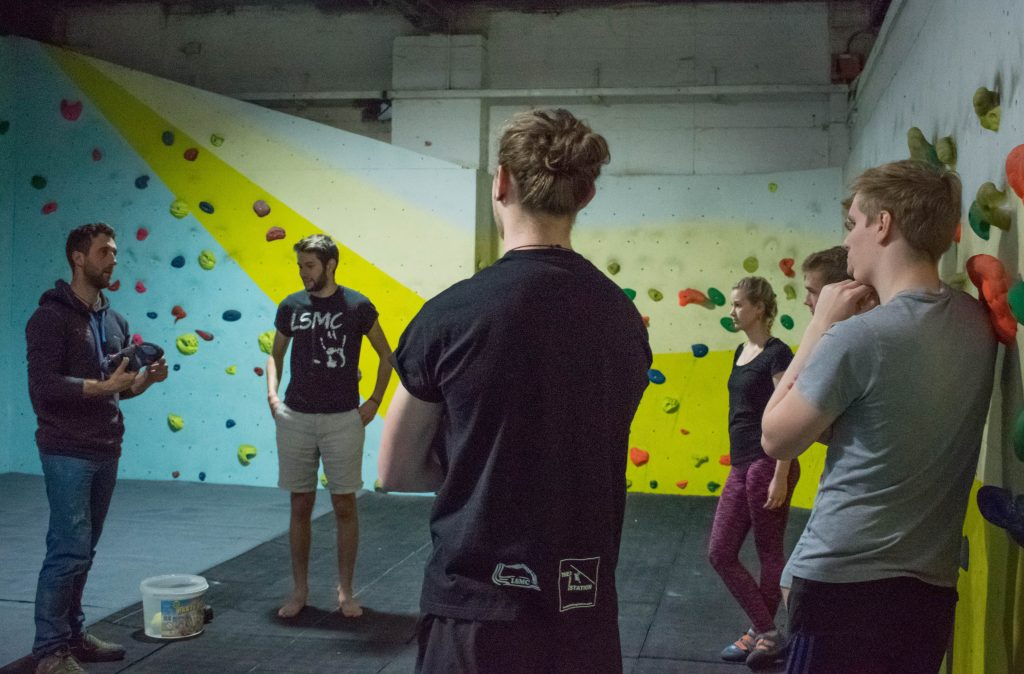 A group of climbers learning about climbing shoes
