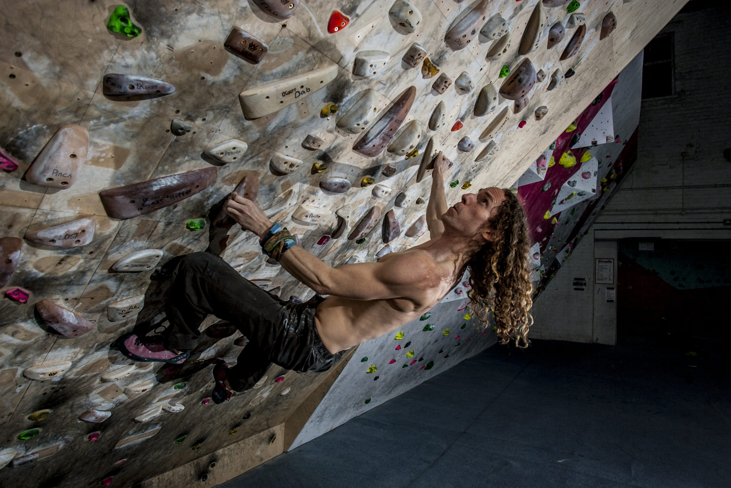Andy Emm climbing the systems board